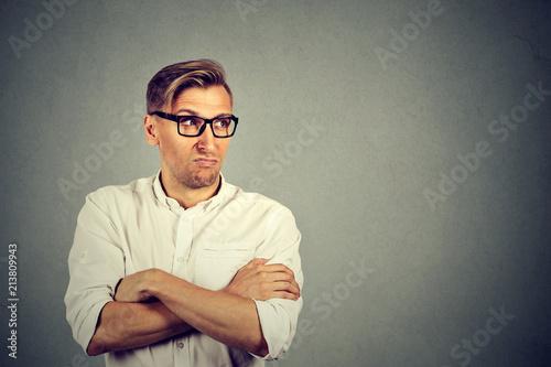 Vászonkép Jealous man looking away in dislike
