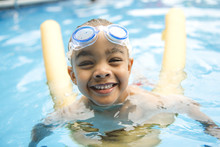 Portrait Of Boy Having Good Time In Swimming Pool