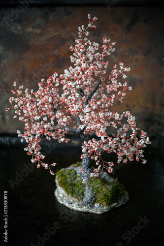 Bonsai Tree Of White And Red Beads And Wire On A Stone Stand With