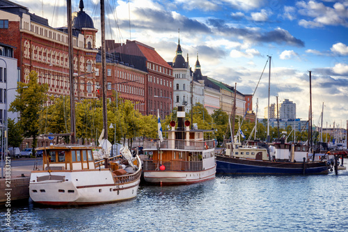 Photo Stands Ship Beautiful cityscape, Helsinki, the capital of Finland, view of the embankment with boats and houses, travel to Northern Europe