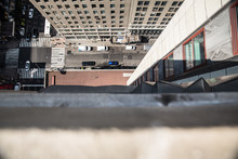 Downwards View From The Ledge Of A Building In New York City With Street Below In View