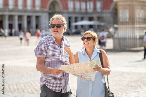 Valokuva Senior couple lost using city map for finding their location in Europe