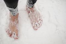 Men's Bare Feet In The Snow