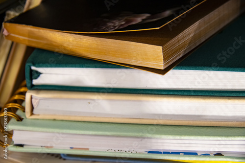 Fotografie, Obraz  Stack of assorted hardback and paperback books or journals - some with bookmarks