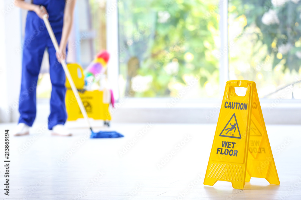 Fototapety, obrazy: Safety sign with phrase Caution wet floor and cleaner indoors. Cleaning service