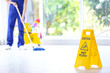 Leinwanddruck Bild - Safety sign with phrase Caution wet floor and cleaner indoors. Cleaning service