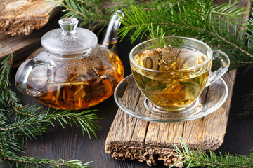 Fototapeta Do herbaciarni Winter healing orange drink with sea buckthorn, rosemary, spice, fir branches