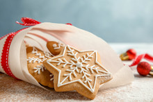 Tasty Decorated Christmas Cookies On Wooden Board, Closeup