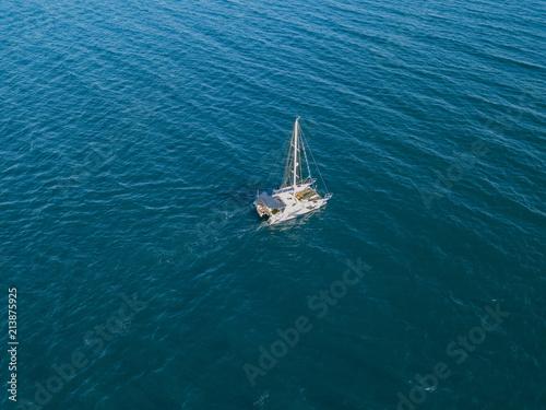 Canvas Print sailing boat catamaran in open sea summer cruise travel concept