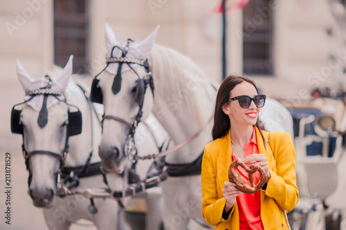 Fotografie, Obraz  Tourist girl enjoying her european vacation in Vienna