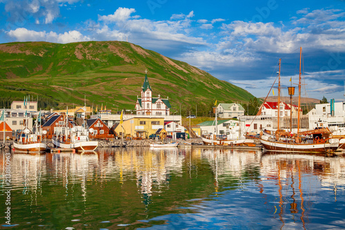 Fotografie, Tablou  Historic fishing town of Husavik at sunset, Iceland