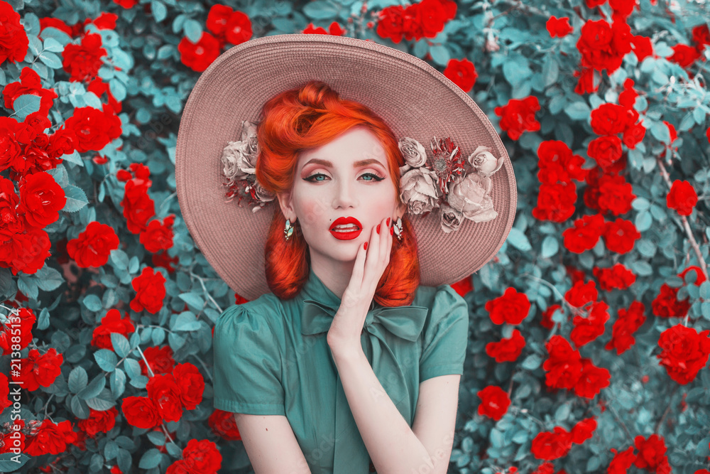 Fototapety, obrazy: Valentines Day background. Fabulous retro girl with red lips in mint dress on awesome summer background. Woman portrait. Awesome redhead model expresses emotions on background of roses bush.