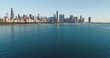 Flying above the buildings to reveal Chicago skyline panorama at lakefront