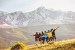 canvas print picture - Group of happy friends against mountains