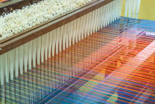 Weaving loom and shuttle on the warp Fototapeta