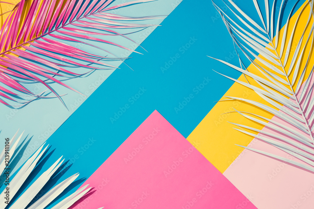 Fototapeta Tropical bright colorful background with exotic painted tropical palm leaves. Minimal fashion summer concept. Flat lay.