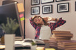 Worn out woman stretching at her desk