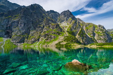 a delightful scenic mountain landscape and a clean lake Czarny Staw