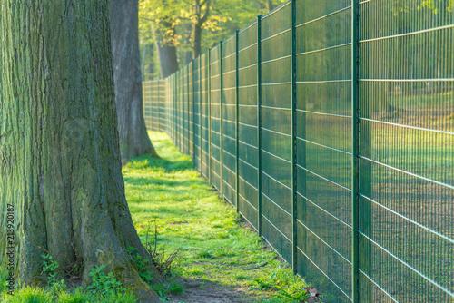 Metal fence in urban Park Tableau sur Toile