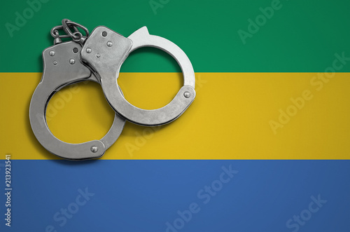 Fotografie, Obraz  Gabon flag  and police handcuffs