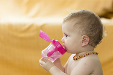 Baby Toddler Wearing Amber Teeth Pain Relief Neckless