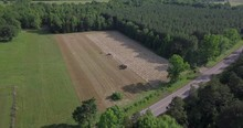 Aerial View Of Two Tractors Ra...