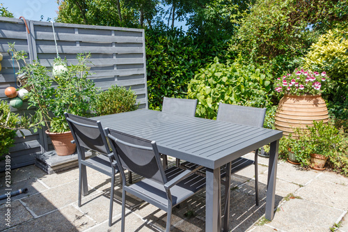 Terrasse fleurie avec salon de jardin - Buy this stock photo ...