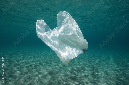 Photo Plastic waste underwater, a plastic bag in the Mediterranean sea between water s