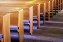 Rows Of Church Pews In An Empt...