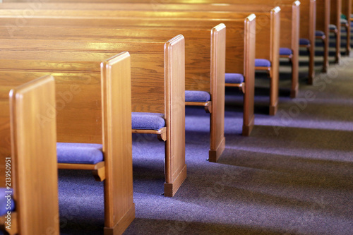 Fotografiet Rows of Church Pews in an Empty Church Sanctuary