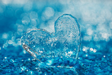 Clean Glass Heart On Blue Beac...