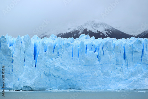 Breathtaking huge ice blue wall of Perito Moreno Glacier in the Los Glaciares National Park, El Calafate, Patagonia, Argentina