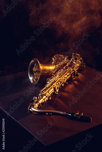 Fényképezés professional shiny saxophone in smoke and backlit on black