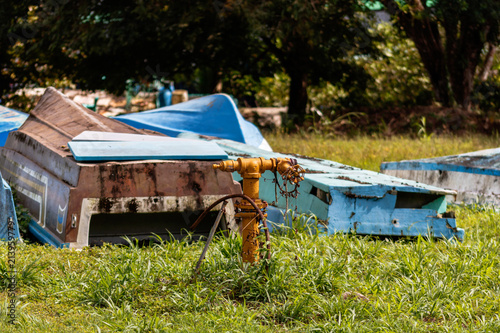 Keuken foto achterwand Schip Old fishing boat on green grass of Golfito, Costa Rica. Day to day life in the small village of Golfito, Costa Rica.