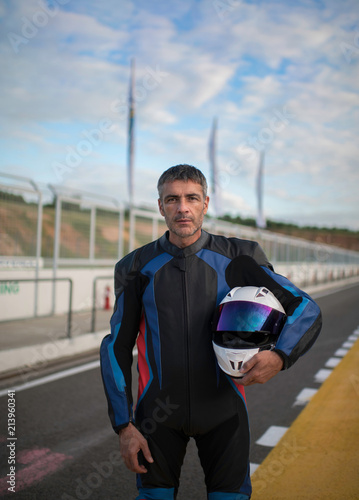Foto op Canvas Motorsport Motorbike driver staying on the track before the race