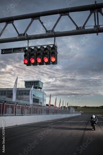 Foto op Plexiglas Motorsport The portrait of motorbike driver driving his bike on the track