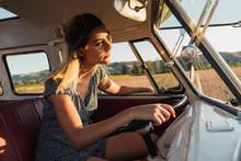 Young Woman Driving Retro Van