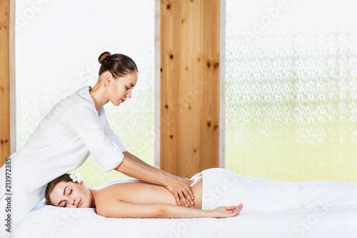Obraz na plátně  Beautiful woman lying on massage table and enjoying massage.