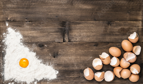 Food background Flour eggs wooden kitchen table
