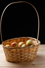Nectarines In A Wicker Basket On A Wooden Table