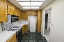 Old 1980s Condo Kitchen With O...