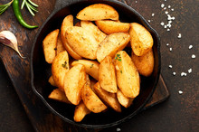 Fried Potatoes In A Pan On Bro...