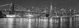 Fototapeta New York - Black and white picture of New York City skyline at night, USA.