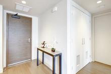 White Entrance Hallway With Co...
