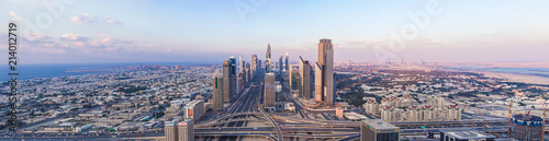 Foto op Aluminium Dubai DUBAI, UAE - FEBRUARY 21, 2014. Panorama aerial view on Dubai main street - Sheikh Zayed Road and skyscrapers in evening on sunset
