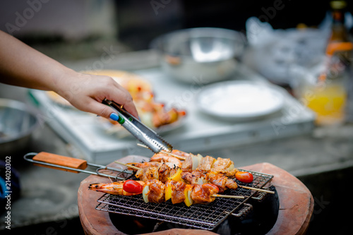 Photo Stands Grill / Barbecue Barbecue grill with various kinds of meat, close-up.