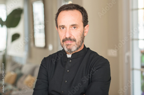 Christian priest man with a confident expression on smart face thinking serious Fototapete