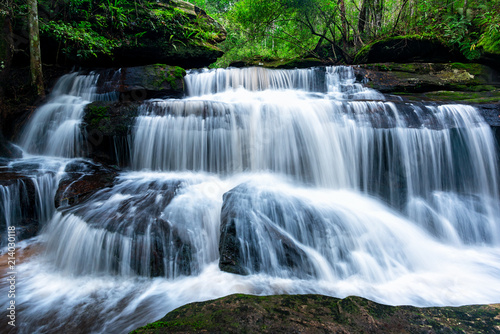 Foto op Plexiglas Watervallen Beautiful deep forest waterfall in Thailand.