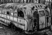 Old Abandoned School Bus From Rear In Black And White