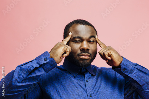 Fotografie, Obraz  Horizontal portrait of a plus size man in blue shirt with fingers on temples, is